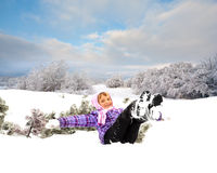 Happy little kid is playing in snow Royalty Free Stock Photography