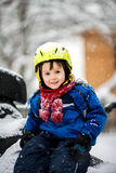 Happy little kid is playing in snow, good winter weather Royalty Free Stock Image