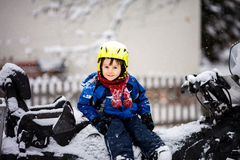 Happy little kid is playing in snow, good winter weather Stock Image