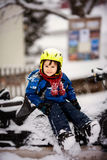 Happy little kid is playing in snow, good winter weather Royalty Free Stock Images