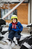 Happy little kid is playing in snow, good winter weather Stock Photos