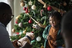 Happy little kid receiving a Christmas present Stock Photo