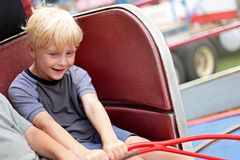Happy Little Kid Riding Tilt-a-whirl Carnvial Ride stock photo