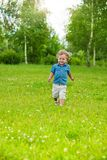 Happy little kid running in park Stock Image