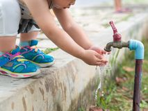 Happy little kid wash the hand. Cleaning, Washing Concept. royalty free stock photos