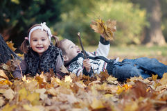 Happy little kids in autumn park Stock Photo
