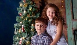Happy little kids  decorate Christmas tree Stock Photos