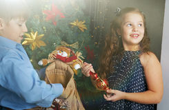 Happy little kids  decorate Christmas tree Royalty Free Stock Image