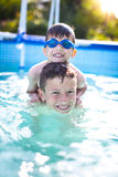 Happy little kids have fun in swimming pool Royalty Free Stock Photos