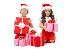 Happy little kids in Santa hat with Christmas gift boxes. Isolated on white background. Sale, holidays, christmas, new year, x-mas concept stock photos