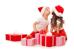 Happy little kids in Santa hat with Christmas gift Stock Image