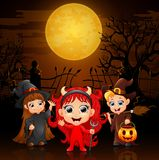 Happy little kids wearing costume halloween in graveyard royalty free illustration