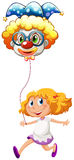 A happy little lady with a clown balloon Stock Photo