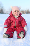 Happy little lovely baby girl 11 months in warm clothes outdoor Royalty Free Stock Photos