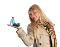 Happy little man. (happy man sitting on a young woman's hand Royalty Free Stock Photo