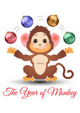 Happy little monkey juggling with baubles Stock Photos