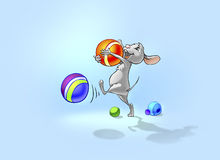 Happy little mouse playing with balls. Stock Photos