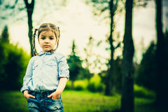 Happy little pretty girl outdoor in the park Royalty Free Stock Image