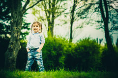 Happy little pretty girl outdoor in the park Royalty Free Stock Images