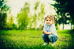 Happy little pretty girl outdoor in the park Stock Photography