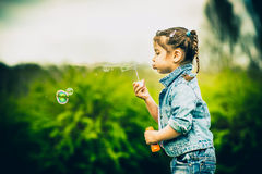 Happy little pretty girl outdoor in the park Royalty Free Stock Photography