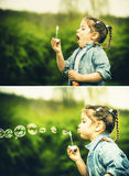 Happy little pretty girl outdoor in the park blowing bubbles Stock Photo