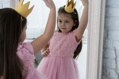 Happy little princess look in to the mirror. Happy little princess look in to the mirror stock photo