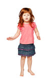Happy little redhead girl dancing and smiling. Stock Photos