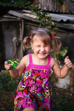 Happy little rural girl with a spinner in her hand royalty free stock photos