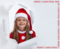 Happy little santa girl with teeth missing, smiling through hole Stock Photos