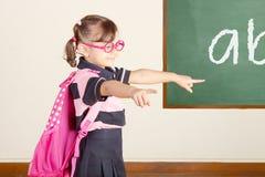 Happy Little School Girl at classroom stock photos