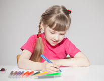 Happy little school girl drawing Royalty Free Stock Photos