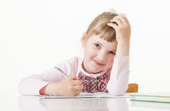 Happy little school girl learning to write Stock Images