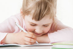 Happy little school girl learning to write Royalty Free Stock Photography