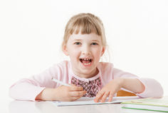 Happy little school girl learning to write Stock Photos