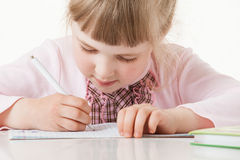 Happy little school girl learning to write Royalty Free Stock Photo