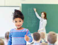 Happy little school girl over classroom background Royalty Free Stock Photography