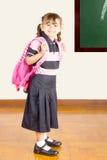 Happy Little School Girl at School Class Room stock photo