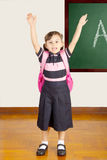 Happy Little School Girl at school classroom royalty free stock photography