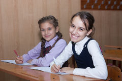 Happy little schoolgirl in the classroom Royalty Free Stock Photos