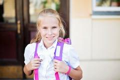 Happy little schoolgirl portrait near school Royalty Free Stock Photos