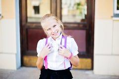 Happy little schoolgirl portrait near school Stock Photography