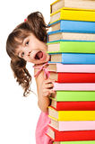 Happy little schoolgirl with a stack of books Stock Photos