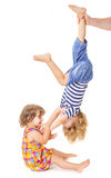 Happy little sister and brother playing Royalty Free Stock Image