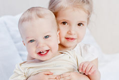 Happy little sister hugging her brother Royalty Free Stock Photography