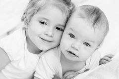 Happy little sister hugging her brother Stock Photography