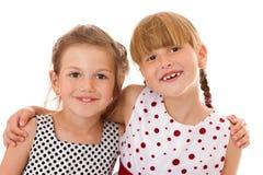 Happy little sisters. Two happy little sisters isolated Stock Photo