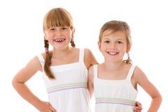 Happy little sisters. Two happy little sisters isolated Royalty Free Stock Photos