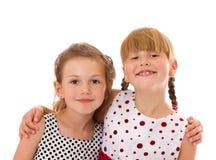 Happy little sisters. Two happy little sisters isolated Stock Photography