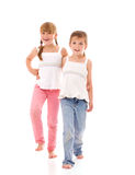 Happy little sisters. Two happy sisters walking together Stock Image
